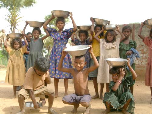 Children participating in village road repair shramadan