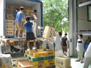 Volunteers loading containers with N. Korea flood relief items
