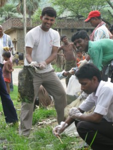 A town developing staff picking up trashes in Jagdishpur
